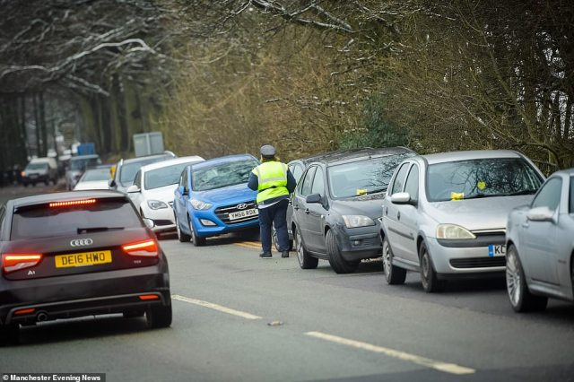 Dovestones Reservoir in Oldham was 'swamped' with visitors as drivers were slapped with fines for parking on double yellow lines as they flocked to see the beauty-spot