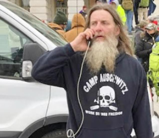 One of those pictured at the Capitol Wednesday wore a racist t-shirt which read 'Camp Auschwitz'. He has been identified as Robert Keith Packer