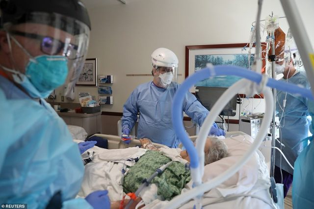Dr. Dan Ponticiello, 43, prepares to intubate a coronavirus disease (COVID-19) patient in the COVID-19 ICU at Providence Mission Hospital in Mission Viejo, California on January 8