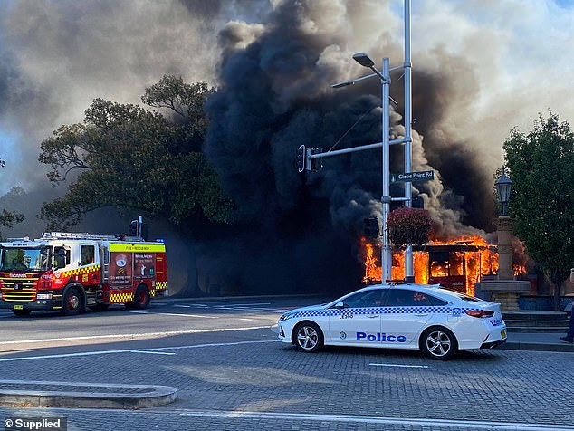 Plumes of smoke were sent billowing into the air after the bus caught fire