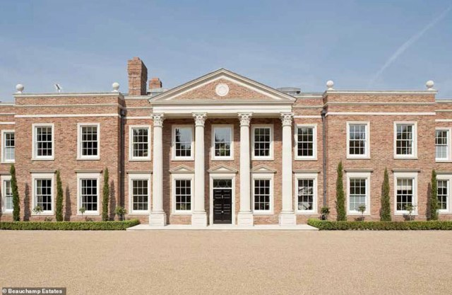 Breathtaking:A mysterious Russian billionaire has bought this sprawling Surrey mansion for £21.5million, it has been revealed