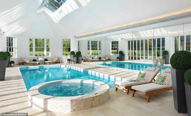 Bringing the spa home: The stunning indoor swimming pool has french doors that open out to the garden and terrace