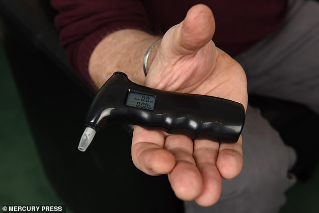 Mr Carson has to constantly carry around a breathalyser to check his blood alcohol content
