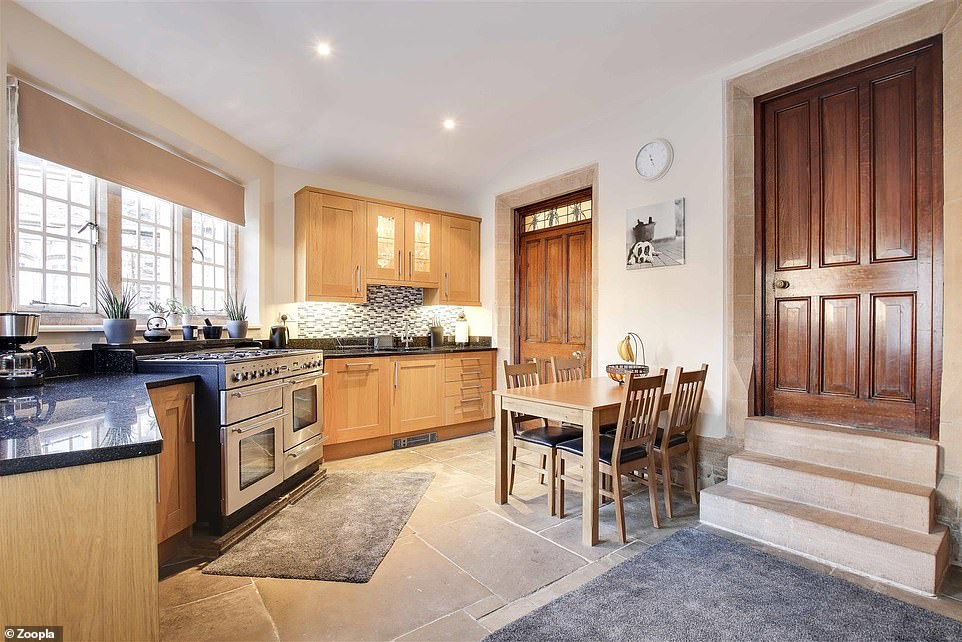The cottage is entered via an unusual semi-circular kitchen, which comes with a stone flooring and steps