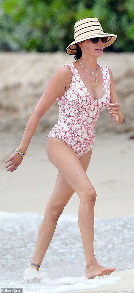 Lauren Silverman shows off her incredible figure while Simon Cowell takes jet-ski ride in Barbados