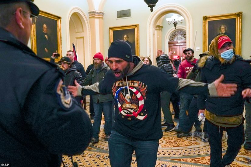 A man in a QAnon hoodie is seen inside the Capitol on Wednesday