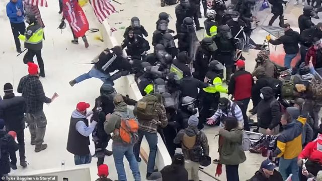 In the two-minute clip, officers are seen trying to fight off a chaotic mob of Trump supporters surging toward barriers around the Capitol building.One of the rioters appears to push an officer off a ledge