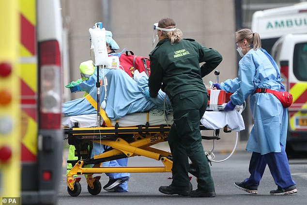 Paramedics transport a patient outside the Royal London Hospital in London