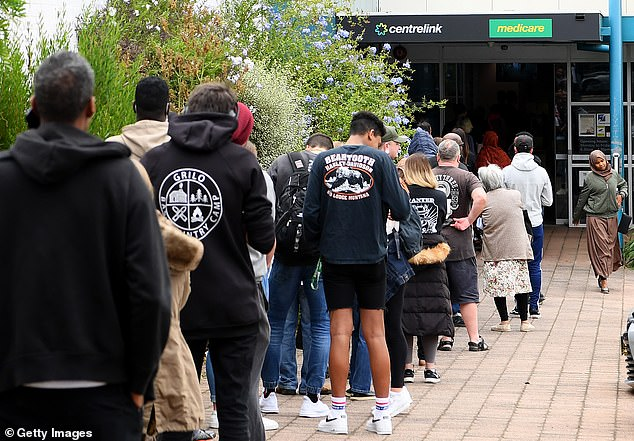 Australians are seen lining up at a Centrelink office in Melbourne at the beginning of the coronavirus pandemic