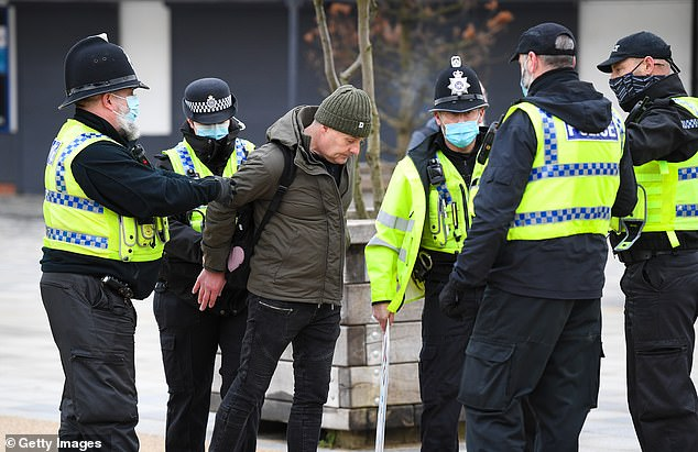 Police arrest an anti-lockdown protester on the seafront on January 9, 2021 in Bournemouth