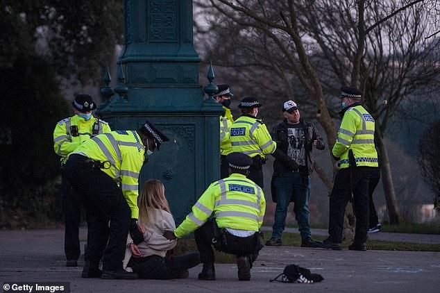 Police detain several anti lockdown protestors in Brockwell Park in Brixton on January 9, 2021