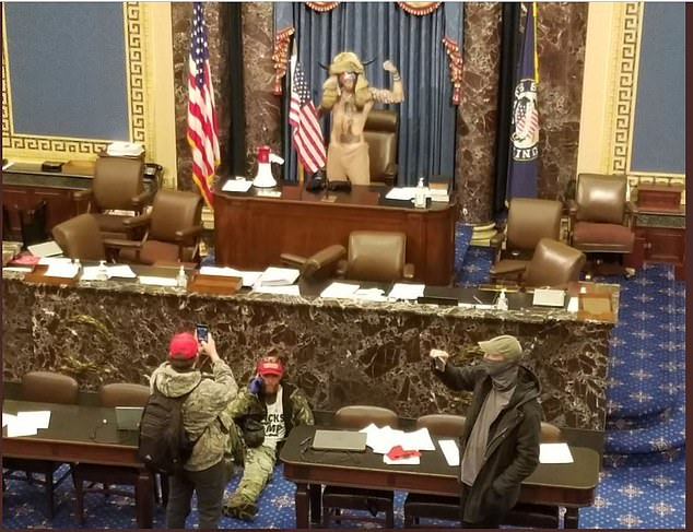 Jacob Anthony Chansley is pictures as he occupied the Senate dais at the US Capitol last week