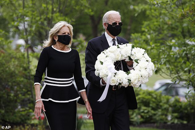 Joe and Jill Biden will lay a wreath at the Tomb of the Unknown Soldier in Arlington on Biden's inauguration day - the two are seen above at a Memorial Day ceremony
