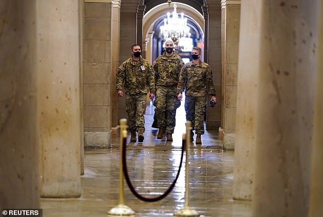 U.S. National Guard members walk among the columns of the crypt beneath the U.S. Capitol rotunda days - more than 6,000 members of the National Guard have already been deployed to help with additional security