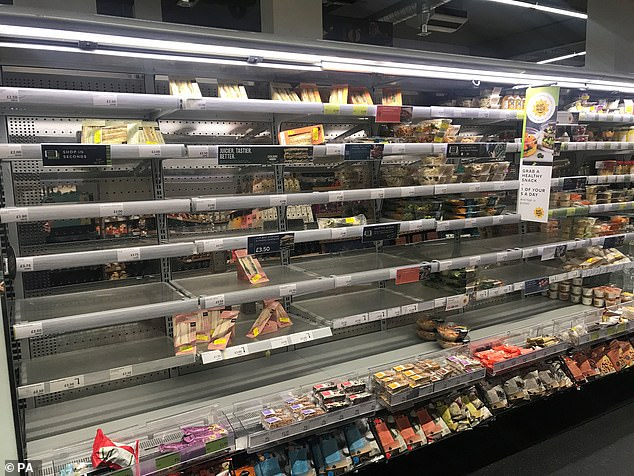 Depleted shelves at the Marks and Spencer store in Donegall Place in Belfast, seen yesterday