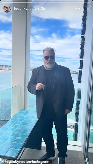 Cute: She then shared a snap of her shock jock beau, who looked smart in a black blazer, black T-shirt and matching jeans