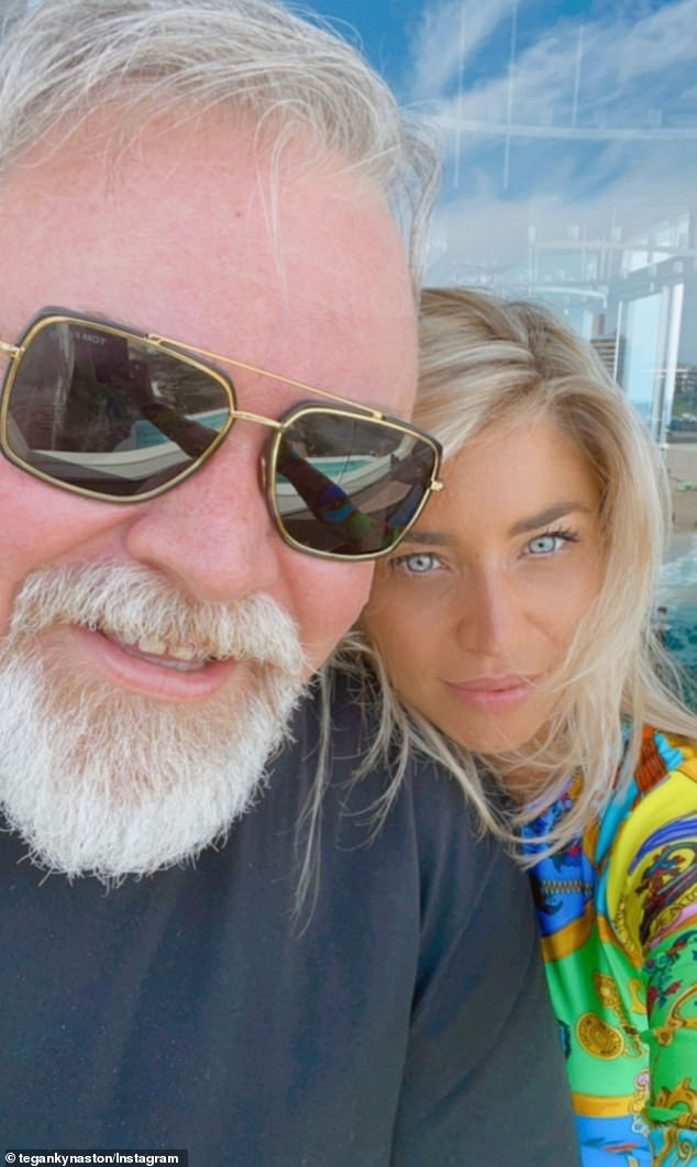 Kyle Sandilands cuddles up to girlfriend Tegan Kynaston in Bondi Beach
