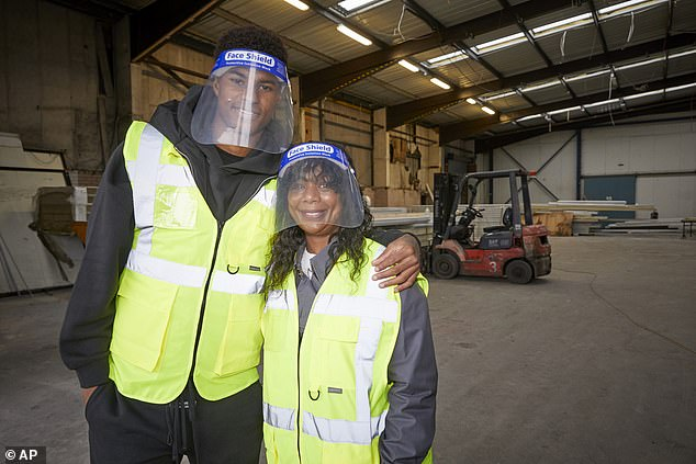The Manchester United and England footballer (pictured with his mother Melanie at a food bank last year) was responding to an outraged mother who slammed a 10-day hamper