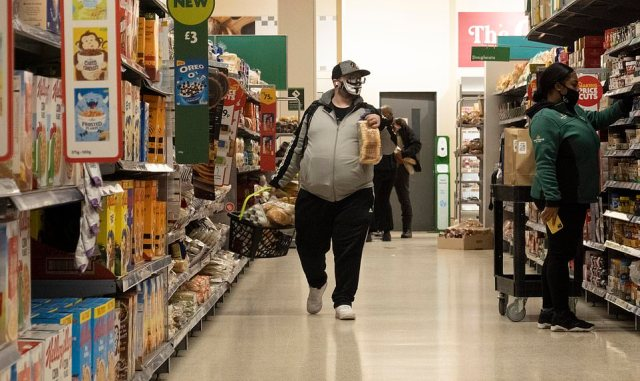 The vast majority of people seen at supermarkets across the UK today - including a Morrisons in London, pictured - were following the rules