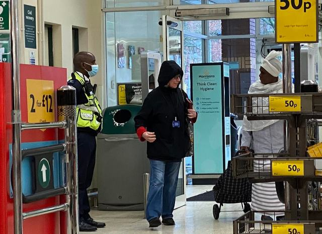 A woman is challenged for not wearing a mask at a Morrisons branch in south-east London. Bouncers are now on the doors of every Morrisons and Sainsbury's store