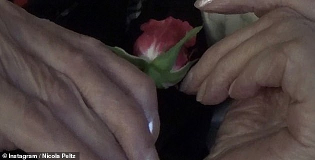 Sweet: Among the images, one of her grandmother's hands holding a beautiful rose