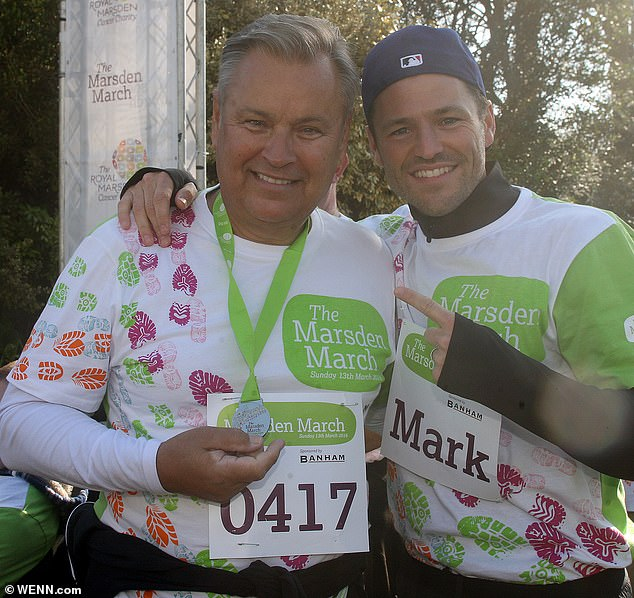 Family: Mark pictured with hisuncle Eddie, who he 'loves dearly', during a sponsored walk in 2016
