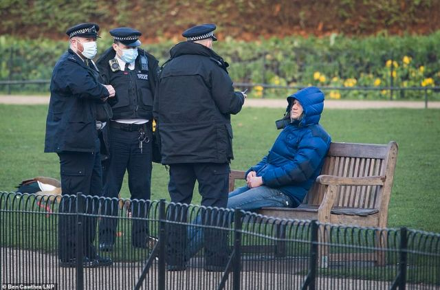 Ministers say someone can stop on a park bench - but only for a short while before moving on. Police pictured in St James' Park on Saturday