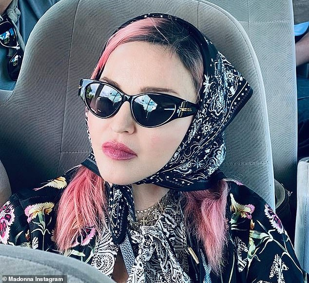Madonna (pictured) has visited Malawi as part of a worldwide holiday, meeting with political figures and often seen unmasked