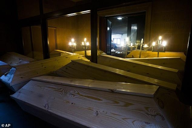 Coffins stored in hallways of crematorium in Meissen, Germany, after surge in Covid deaths