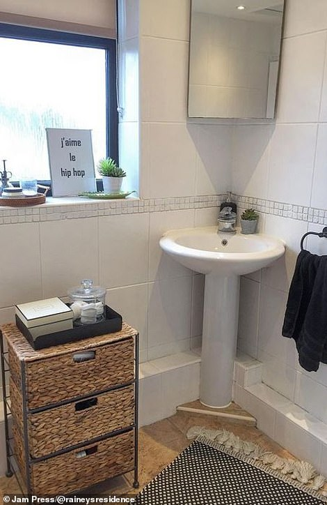 Amberley completely transformed the bathroom with modern touches and a new white tiles. Pictured, the finished bathroom