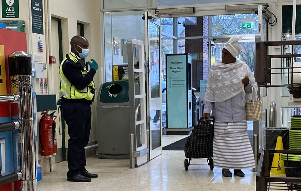 Read my lips? Security guard remonstrates with woman entering a Morrisons without a mask in London