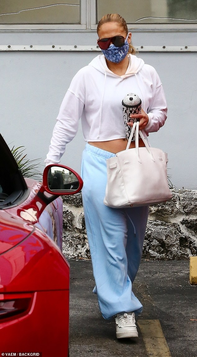 Jennifer Lopez flashes midriff in cropped hoodie and baggy sweatpants as she heads to lunch in Miami