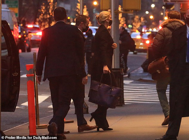 She was surrounded by her security detail as she walked out into the night Tuesday