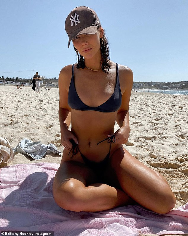 Bikini-clad Bachelor star Brittany Hockley flaunts her figure at the beach