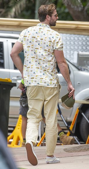 Looking good: Liam wore light beige chinos and an off-white patterned shirt with short sleeves