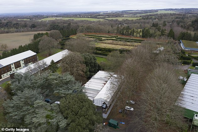 A temporary mortuary is set up in the grounds of Headley Court in Leatherhead, Surrey on January 11, after local morgue services begin to reach capacity