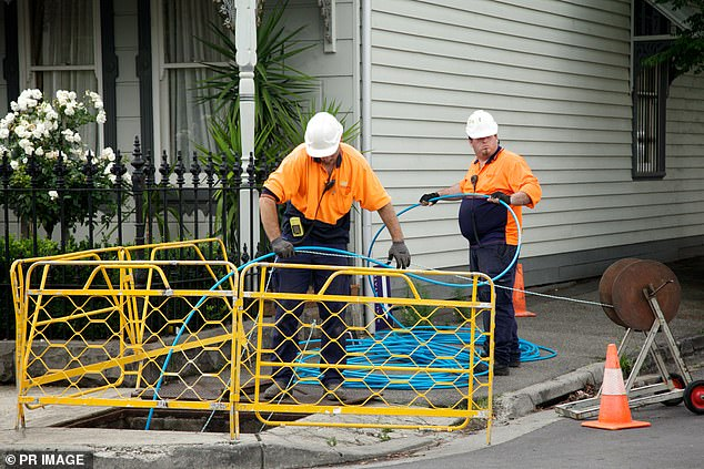 LNP Government's change to use a second-rate copper wire system instead of the Labor government's fire to the premises scheme has caused the slow speed. Pictured: communication construction workers