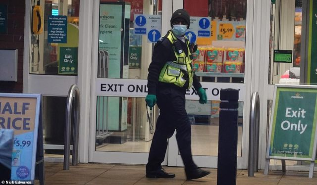 A security guard on patrol outside theMorrisons supermarket in Peckham, South East London, this morning