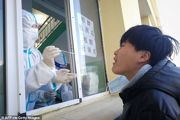 The authorities in Heilongjiang Province - with a population of 37.5 million people - declared an 'emergency state' on Wednesday. Pictured: A medic conducts a test on a resident in Qiqihar, Heilongjiang