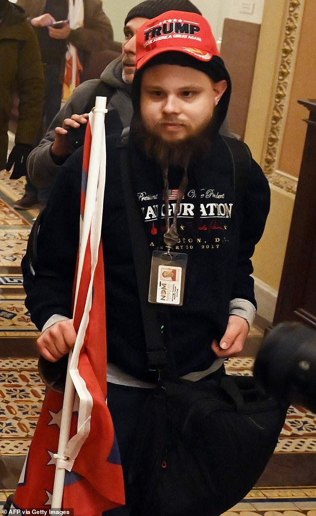 A Maryland marketing company has fired a pro Trump rioter who walked through the Capitol with his work pass hanging around his neck on Wednesday
