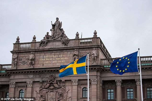 Migrants will have to show proof of Swedish language skills and understanding of the country's culture in order to become citizens. Pictured:The Swedish and EU flags fly in front of the Swedish Parliament on April 16, 2020 in Stockholm