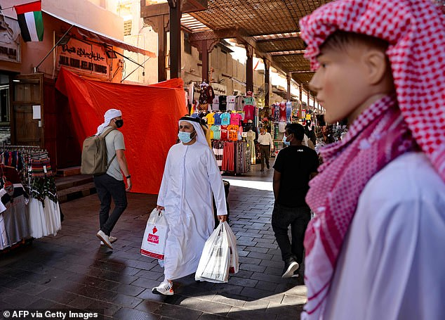 Even when testing negative before entering the UK becomes mandatory, many are concerned that the relative ease of getting a vaccine abroad could fail to deter people from international travel. Emiratis wear face masks as they shop at the Dubai grand market on Wednesday of last week