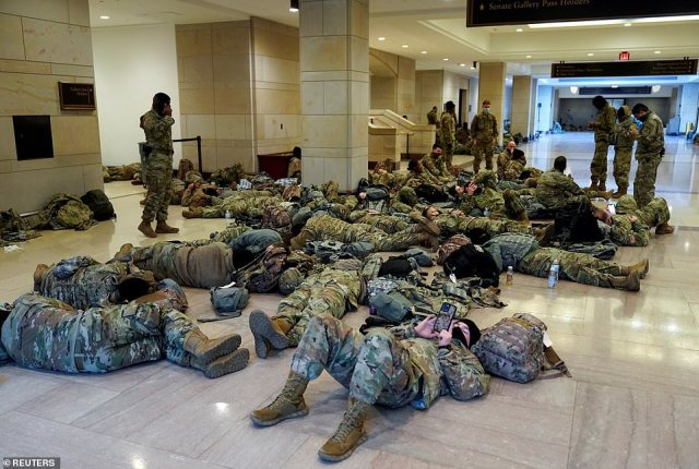 National Guard members sleep in the Capitol Vistor's Center on Capitol Hill on Wednesday morning