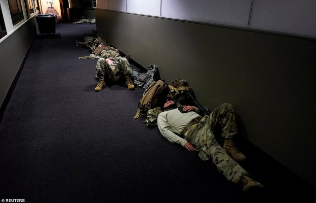 On Wednesday morning, members of the National Guard are pictured sleeping in the Dirksen Senate Office Building