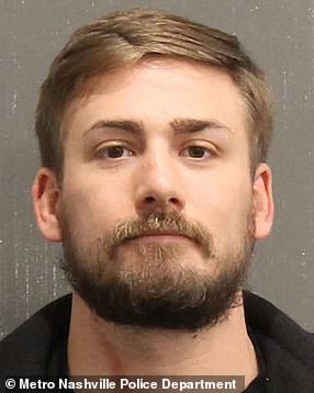 Eric Munchel, 30, is pictured in his mugshot having been arrested in Nashville on Sunday