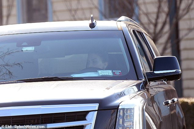 Out: The mother to five was seen behind the wheel of a large black SUV while she drove through the affluent seaside neighborhood