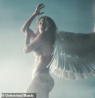 Cherub: Her caramel colored tresses were parted down the middle and worn short across her shoulders with a massive pair of wings attached to her back