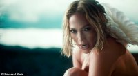 Jennifer Lopez reveals her impeccable abs as she dances NAKED in a forest for In The Morning video