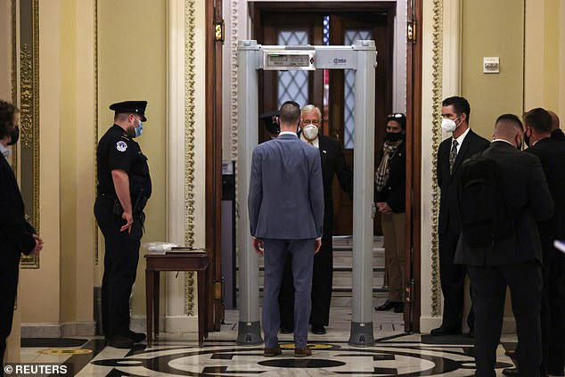 House Majority Leader Steny Hoyer, Democrat of Maryland, goes through a new metal detector as he walks to the floor of the House of Representatives