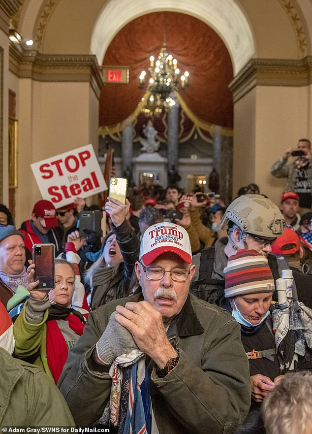 A view of the Trump-inspired mob storming the Capitol Building on January 6 to protest the certification of the presidential election above